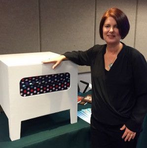 Kelley Styring and the box used in her experiment.