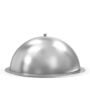 A large, silver platter covered by a domed lid.
