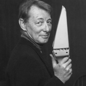 Carroll Gantz holding the DustBuster handheld vacuum cleaner, which he designed.