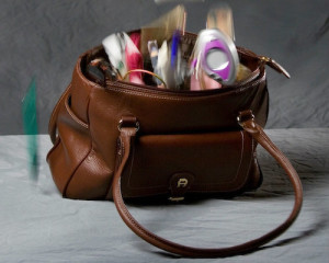 Woman's purse, overflowing with personal items